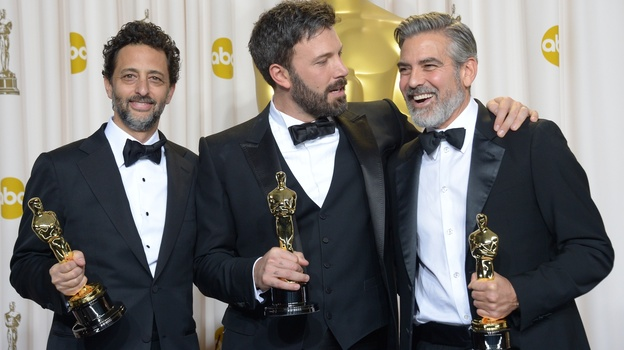 Ben Affleck (center), George Clooney (right) and Grant Heslov celebrate in the press room after winning the Oscar for best picture for <em>Argo.</em>