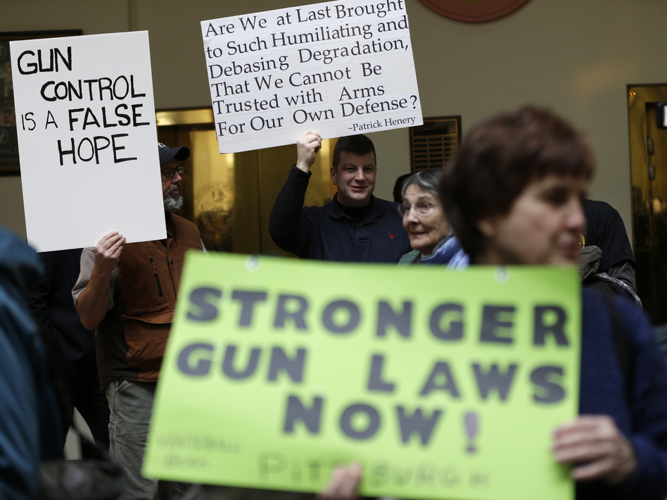 Advocates for and against stronger gun laws demonstrate in the Pennsylvania Capitol on Jan. 23 in Harrisburg, Pa. (Matt Rourke/AP)