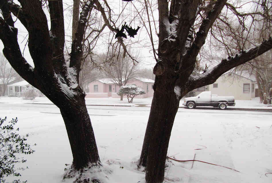 Blizzard conditions persist in Lubbock, Texas, on Monday. The storm system packing snow and high winds has
