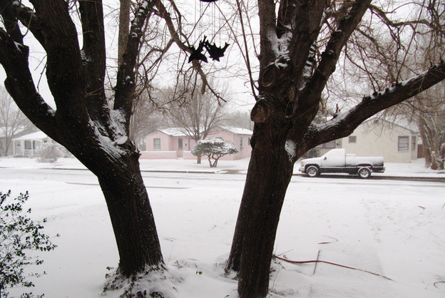 Blizzard conditions persist in Lubbock, Texas, on Monday. The storm system packing snow and high winds has been tracking eastward across western Texas toward Oklahoma, Kansas and Missouri.