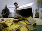 Workers open ballots in a polling station in Rome on Tuesday following Italy's general elections. The initial results showed a close race with no clear-cut winner, a development that made financial markets jumpy.