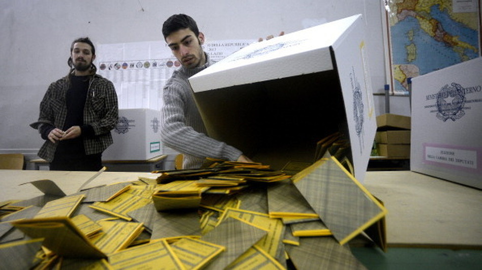 Workers open ballots in a polling station in Rome on Tuesday following Italy's general elections. The initial results showed a close race with no clear-cut winner, a development that made financial markets jumpy. (AFP/Getty Images)