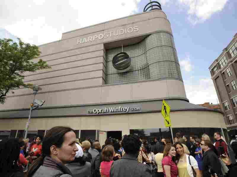 Members of the studio audience wait outside Harpo Studios before the final taping of The Oprah Winfrey Show in Chicago in May 2011.
