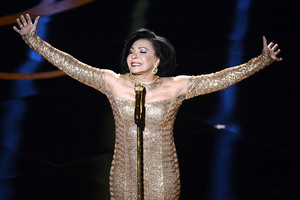 The legendary Shirley Bassey makes an appearance to sing the theme song from the James Bond classic