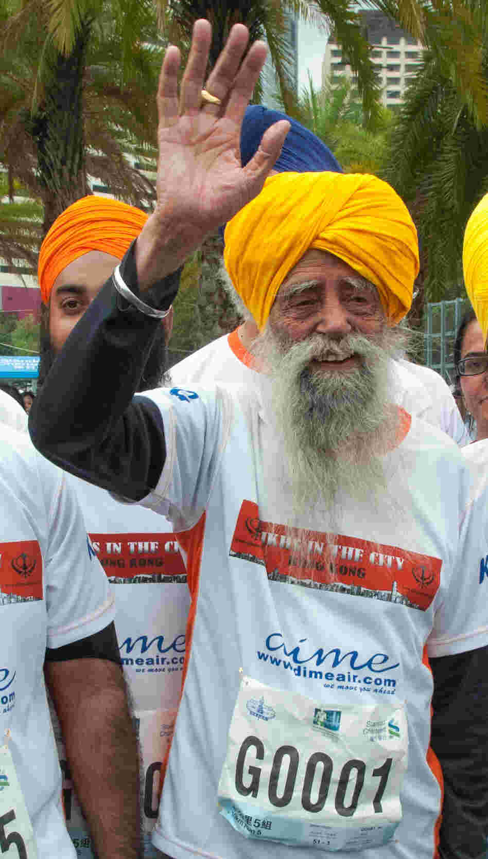 "Fauja Singh, the 101-year-old ""turbaned tornado,"" with other runners Sunday in Hong Kong."