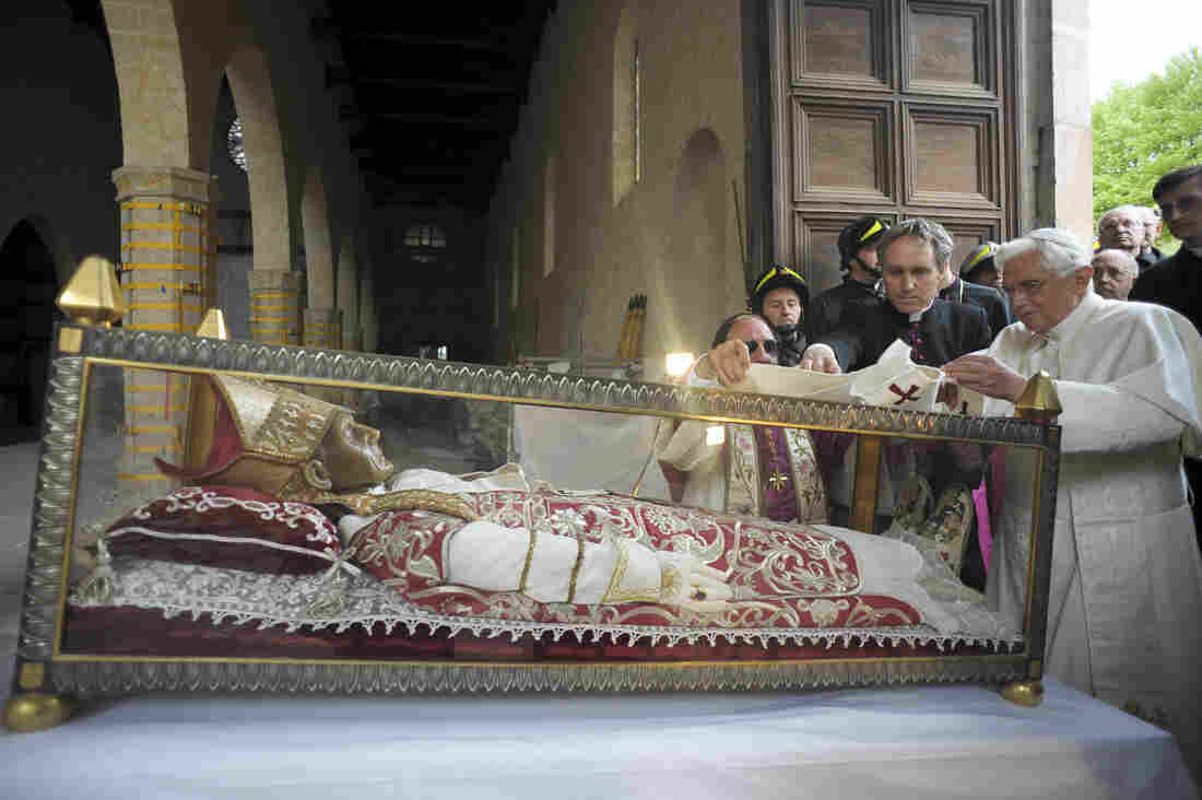 Pope Benedict XVI stands by the salvaged remains of Pope Celestine V, in the 13th-century Santa Maria di Collemaggio Basilica, in L'Aquila, Italy, in 2009.