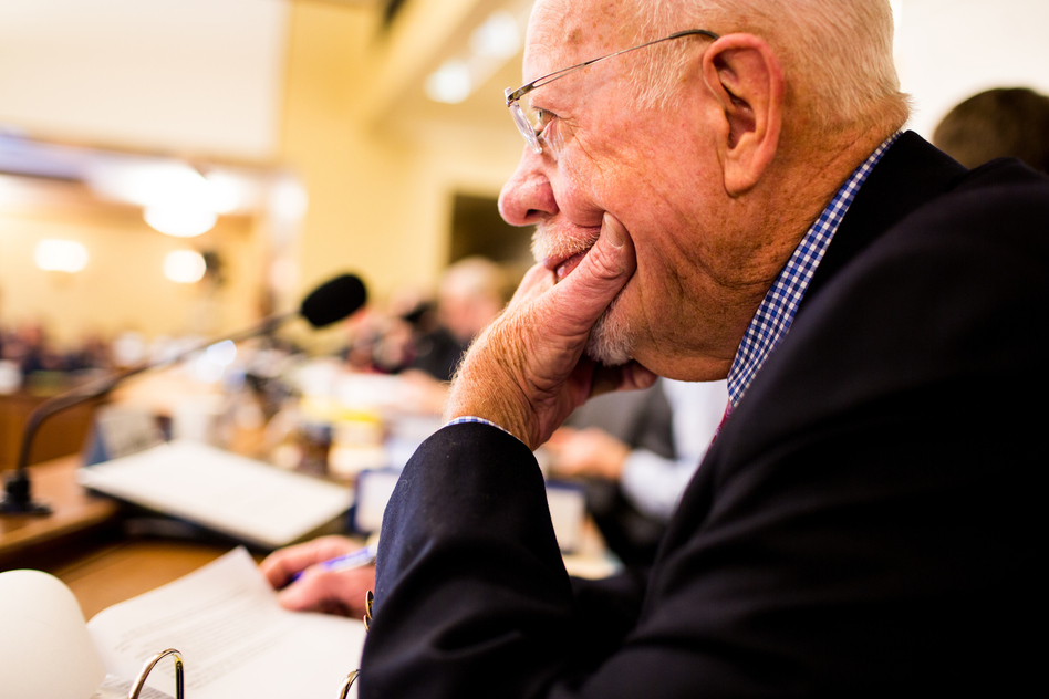 Risser listens during a committee meeting at the state Capitol. He has seen the Legislature change over the decades from a body made up exclusively of white men to one that includes women and minorities. (Narayan Mahon for NPR)
