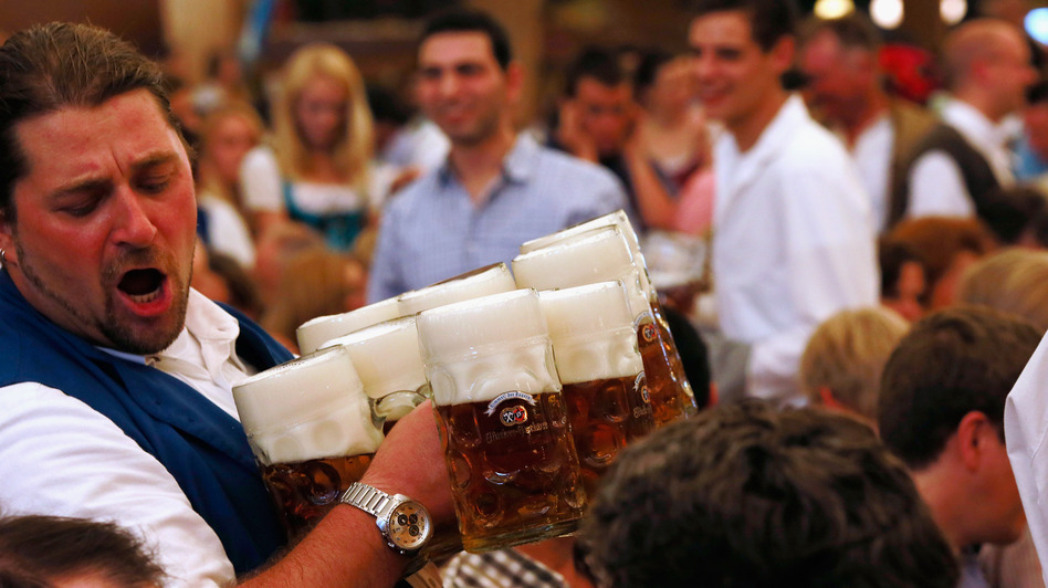 A waiter carries beer mugs during the 2012 Oktoberfest in Munich. (Getty Images)