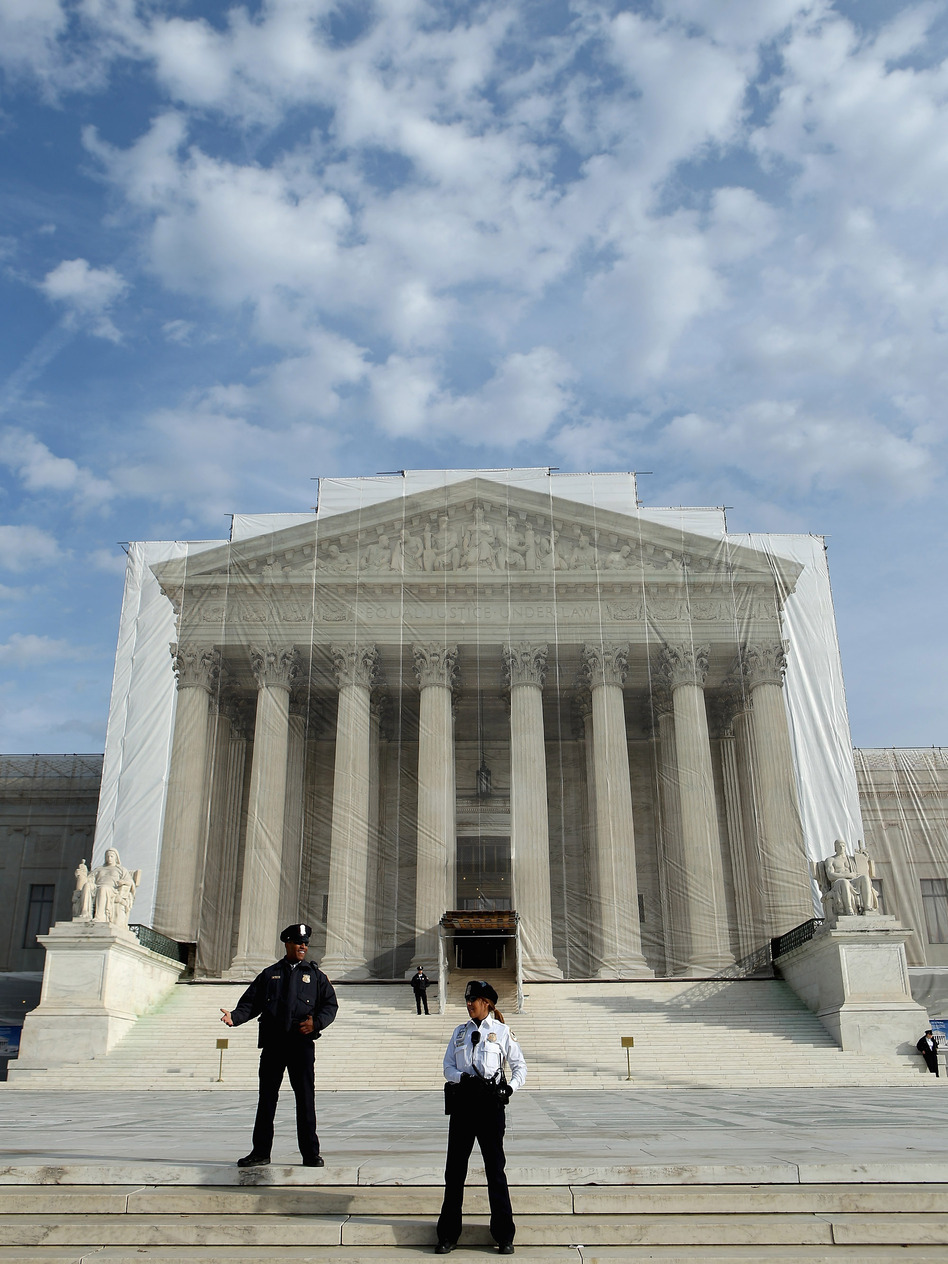 U.S. Supreme Court Police officers stand on the steps in front of the court building in November.