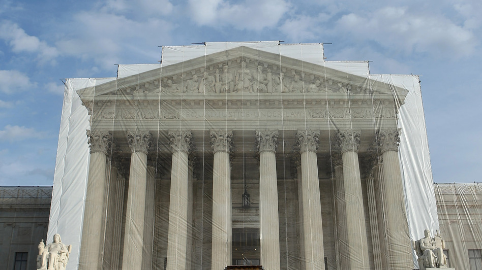 U.S. Supreme Court Police officers stand on the steps in front of the court building in November. (Getty Images)