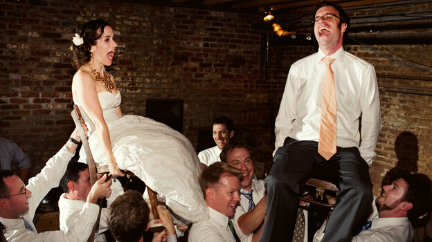"Young newlyweds are serenaded with the strains of ""Hava Nagila."" The unlikely origins of the popular Jewish standard are explored in Roberta Grossman's documentary fea"
