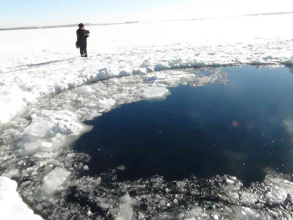 A circular hole in the ice of Chebarkul Lake, where the Chelyabinsk meteor reportedly struck on F