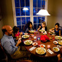 The Brown-Spencer family gathers for dinner at their home in Mechanicsville, Va. This family of eight manages to eat together nearly every weeknight, but they've had to cut back on many after school activities to make it work. From left: Doug Brown, Laura, Celedonia, Anna, Miriam, Anita, Amy Spencer and Gavin.