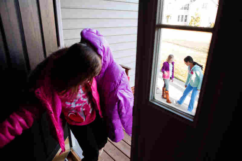 Laura, 6 (from left), Anna, 8, and Anita, 13, head out to the cul-de-sac to play before dinner. The kids get most of their exercise roller-skating, biking or playing ball after school.