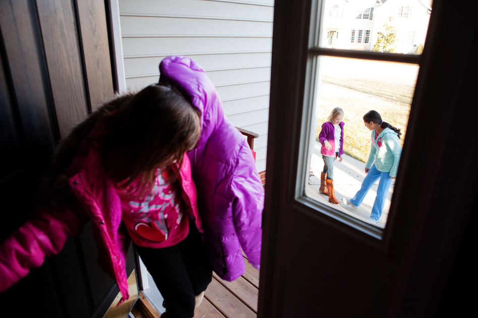 Laura, 6 (from left), Anna, 8, and Anita, 13, head out to the cul-de-sac to play before dinner. The kids get most of their exercise roller-skating, biking or playing ball after school. (NPR)
