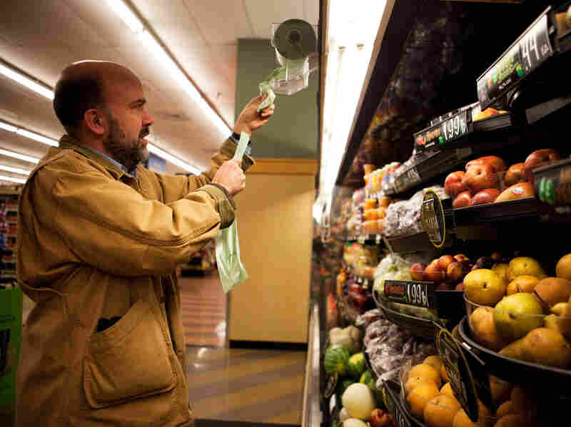 Brown stops by the grocery story after work to pick up ingredients for a fruit salad that he plans to make for dinner.