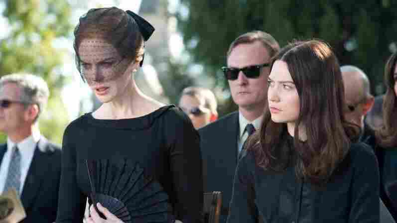 Evelyn and India Stoker (Nicole Kidman and Mia Wasikowska) slowly descend into icy paranoia after their family patriarch dies through suspicious circumstances in the horror thriller Stoker.