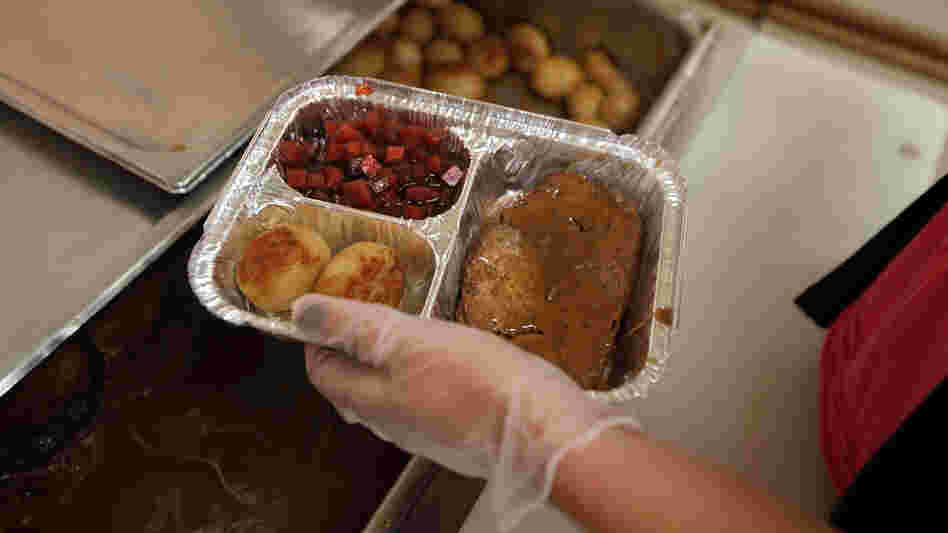 A nutrition specialist prepares a Meals on Wheels delivery in upstate New York. The national organization says the sequester could mean significant cuts in the number of meals they serve to homebound seniors.