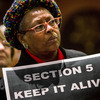 A supporter of the Voting Rights Act attends a rally Columbia, S.C., on Tuesday.