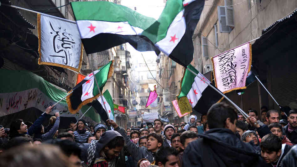 Secular demonstrators, shown at a protest march this month in Aleppo, wave the