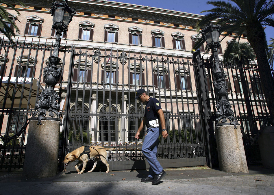 An Italian security policeman checks the main entrance of the U.S. Embassy in downtown Rome in 2008, ahead of a visit by President George W. Bush. The embassy building is over 300 years old and was once the home to the first queen of Italy, Margherita. (AP)