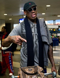 Former NBA star Dennis Rodman, in the departure hall of Beijing Capital International Airport on Tuesday, before his flight to North Korea.