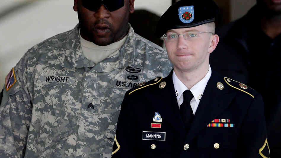 Army Pfc. Bradley Manning (right) is escorted out of a courthouse in Fort Meade, Md., on June 25, 2012. His lawy