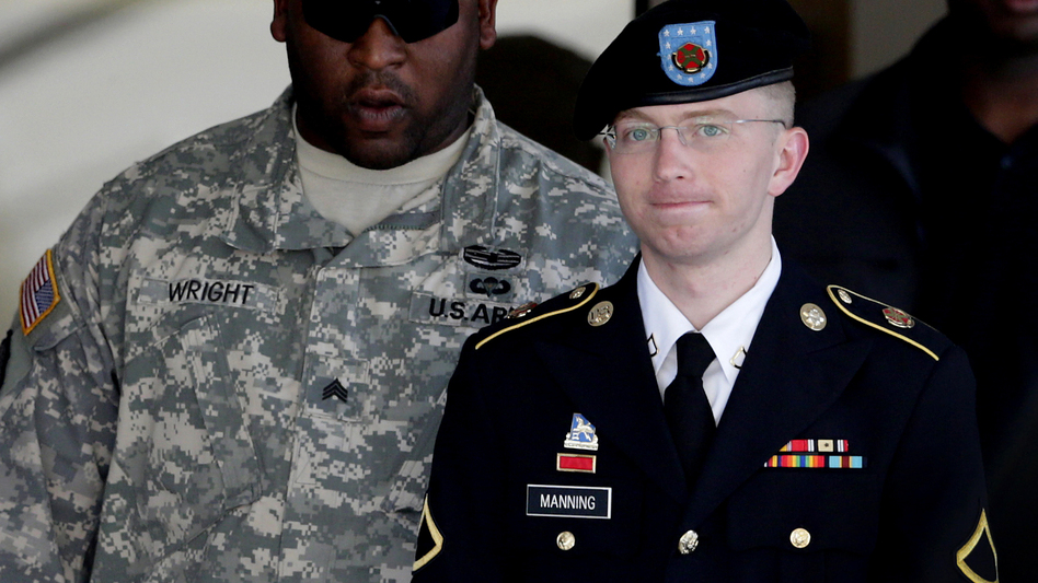 Army Pfc. Bradley Manning (right) is escorted out of a courthouse in Fort Meade, Md., on June 25, 2012. His lawyer announced that Manning, who is accused of leaking classified information to WikiLeaks, had agreed to plead guilty to lesser charges. (Patrick Semansky/AP)