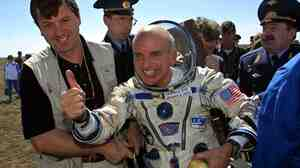 Space tourist Dennis Tito celebrates after his landing near the Kazakh town of Arkalyk on May 6, 2001.
