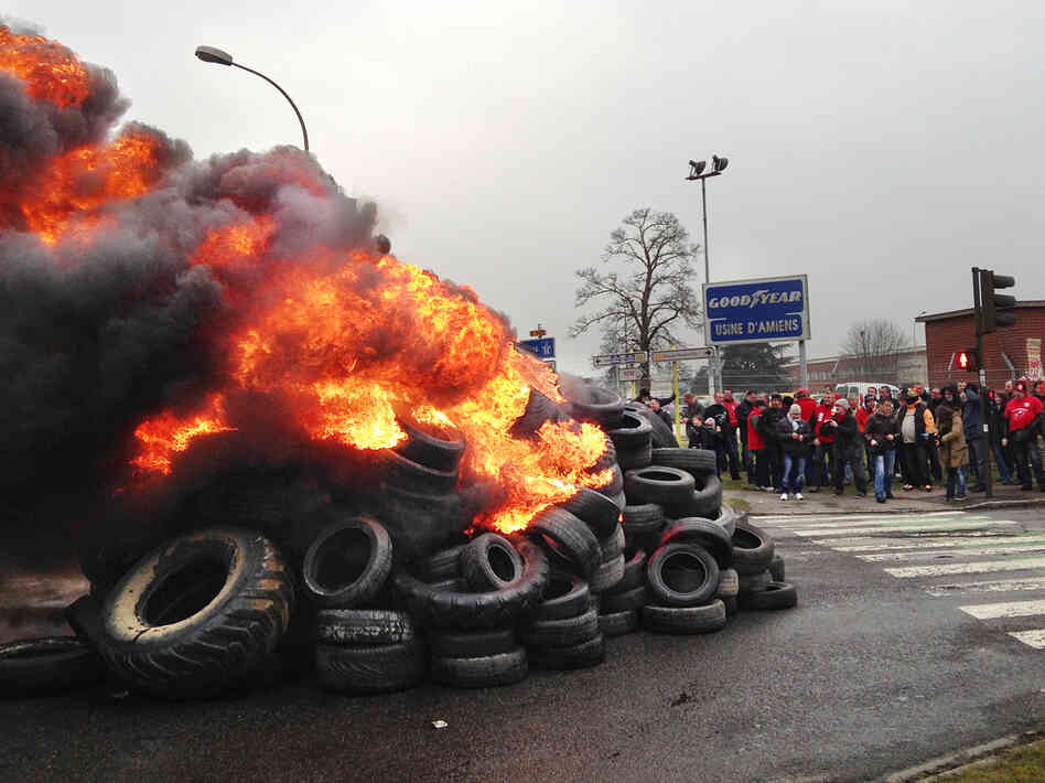 French workers burn tires outside the Goodyear tire factory in Amiens, France, on Tuesday, after Titan CEO Maurice Taylor criticized Frenc