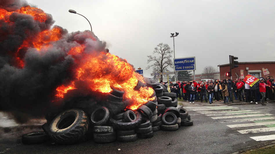 French workers burn tires outside the Goodyear tire factory in Amiens, France, on Tuesday, after Titan CEO Maurice Taylor criticized French workers in a letter addressed to Industrial Renewal Minister Arnaud Montebourg. (NPR)