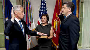 New Defense Secretary Chuck Hagel, left, as he was sworn in Wednesday morning at the Pentagon. His wife, Lilibet, held the Bible. Michael L. Rhodes, the Pentagon's director of administration and management, administered the oath.