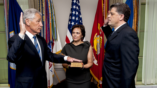 New Defense Secretary Chuck Hagel, left, as he was sworn in Wednesday morning at the Pentagon. His wife, Lilibet, held the Bible. Michael L. Rhodes, the Pentagon's director of administration and management, administered the oath. (Office of the Secretary of Defense)