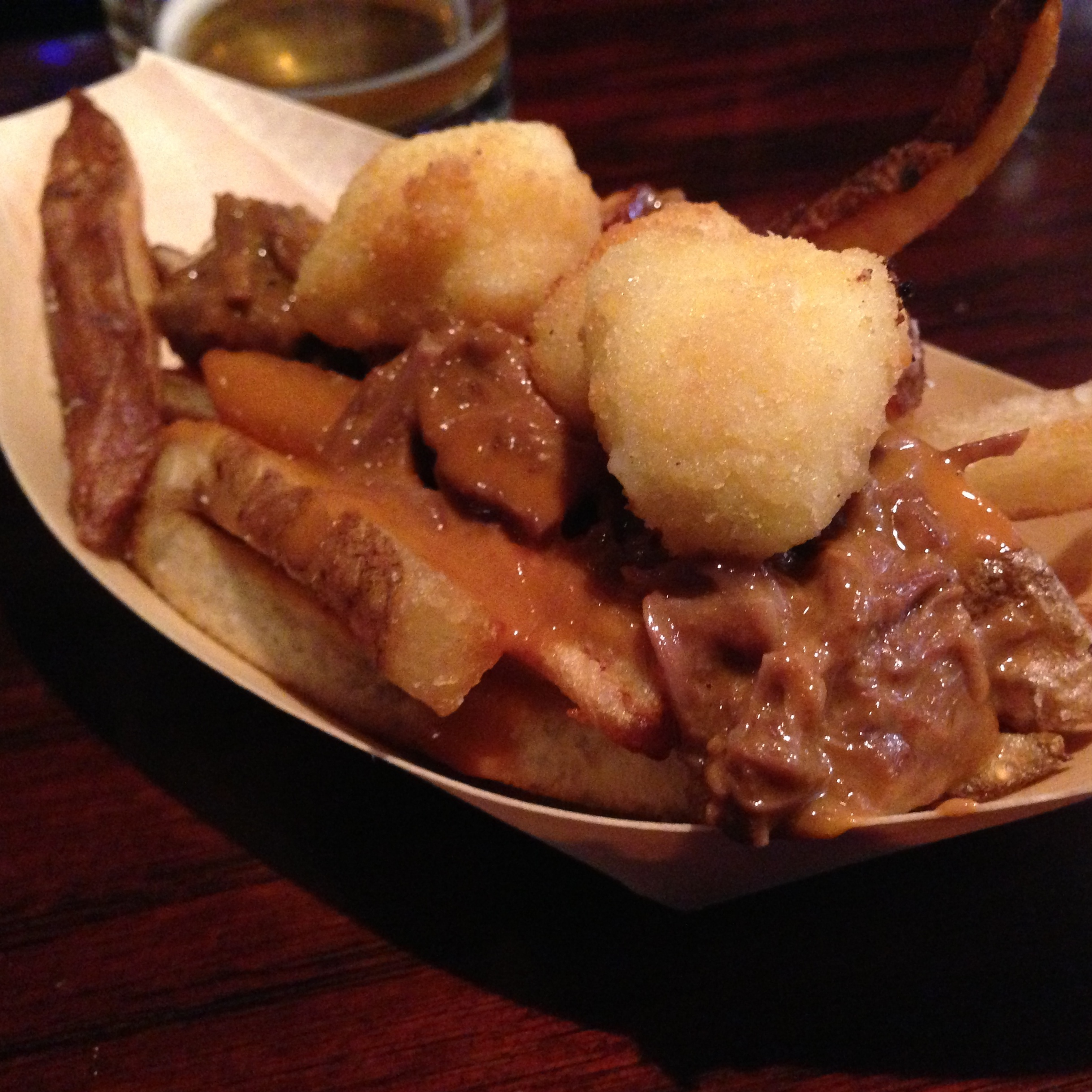 Little Market's poutine served in its traditional dish, a seven-passenger boat.