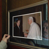 """Bernie McDaid keeps a framed photo of his meeting with Pope Benedict by his front door. """"It was a tough moment,"""" McDaid says."""