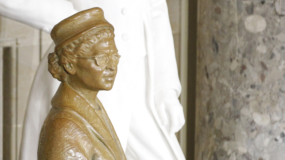 President Obama reached out to touch the statue of civil rights icon Rosa Parks during Wednesday's dedication ceremony in the U.S. Capitol. Senate Minority Leader Mitch McConnell, R-Ky., was behind the president. (Reuters /Landov)