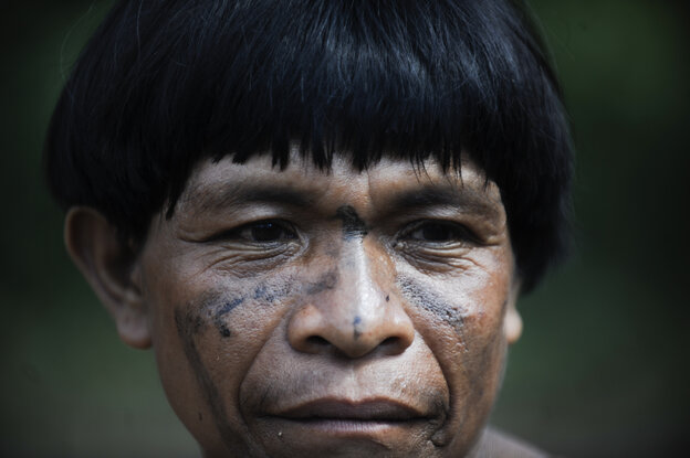 A member of the Ya̧nomamö people at Irotatheri community in Venezuela's Amazonas state, near the Brazilian border, in September 2012.