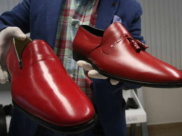 Armando Martin Dueñas shows replicas of the hand-crafted loafers given to Pope Benedict XVI.