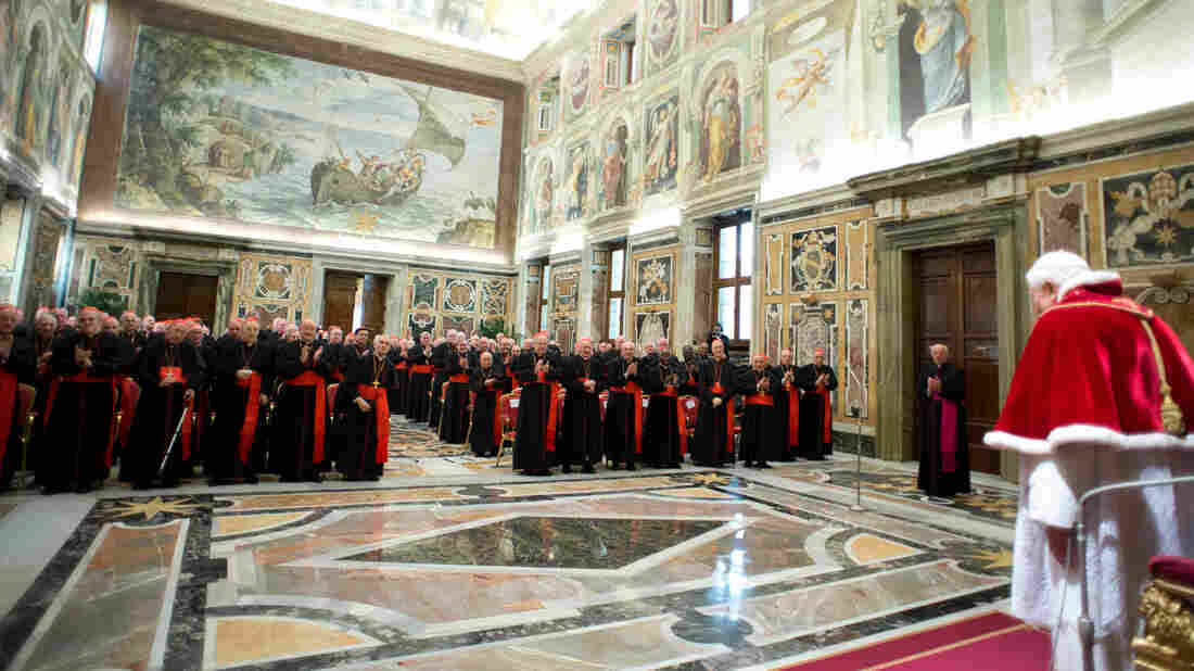 """In this photo provided by the Vatican newspaper L'Osservatore Romano, Pope Benedict XVI delivers his message during his farewell meeting to cardinals Thursday. Benedict promised his """"unconditional reverence and obedience"""" to his successor."""