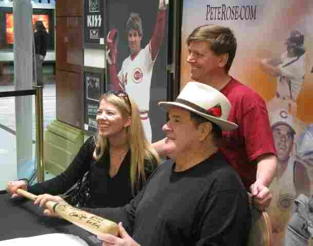 Pete Rose (front, right) poses with fans Scott and Tiffany Van Alstyne at the Art of Music memorabilia store in Las Vegas. Every week, he goes to the store to sign autographs.