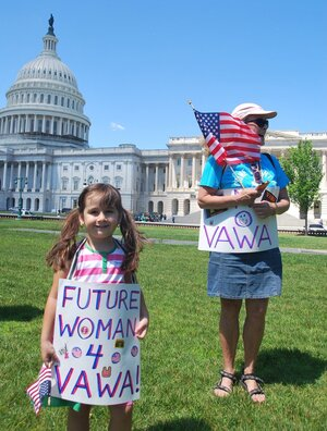 Supporters of the Violence Against Women Act rally in front of the U.S. Capitol last June. On Thursday, the House passed a reauthorization measure.