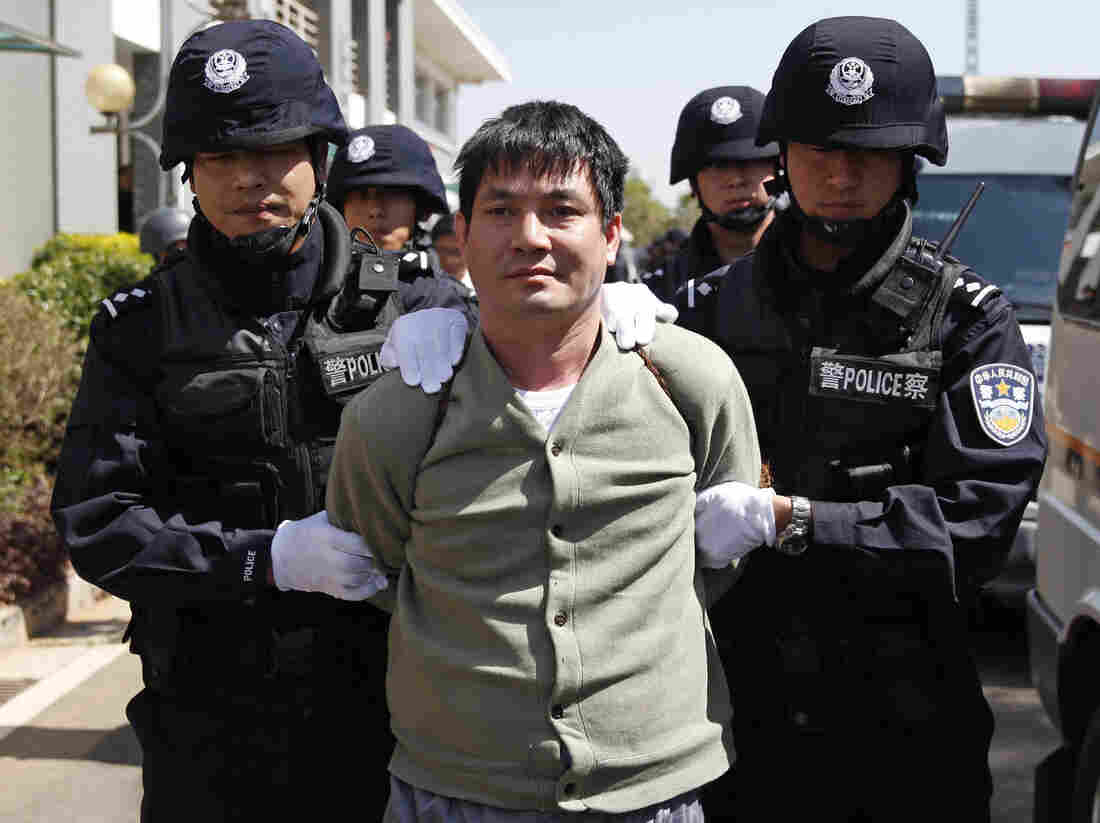 Naw Kham is taken to the execution chambers on Friday.