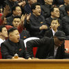 Kim Jong Un and Dennis Rodman watch North Korean and U.S. players in an exhibition basketball game at an arena in Pyongyang on Thursday.