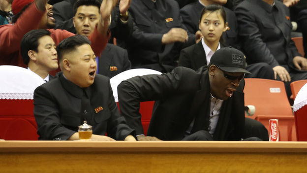 Kim Jong Un and Dennis Rodman watch North Korean and U.S. players in an exhibition basketball game at an arena in Pyongyang on Thursday. (Associated Press)