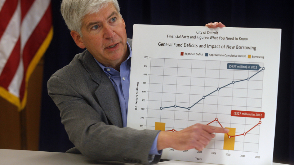 Michigan Gov. Rick Snyder in February displays a chart to illustrate the troubled state of Detroit's finances. (Reuters /Landov)