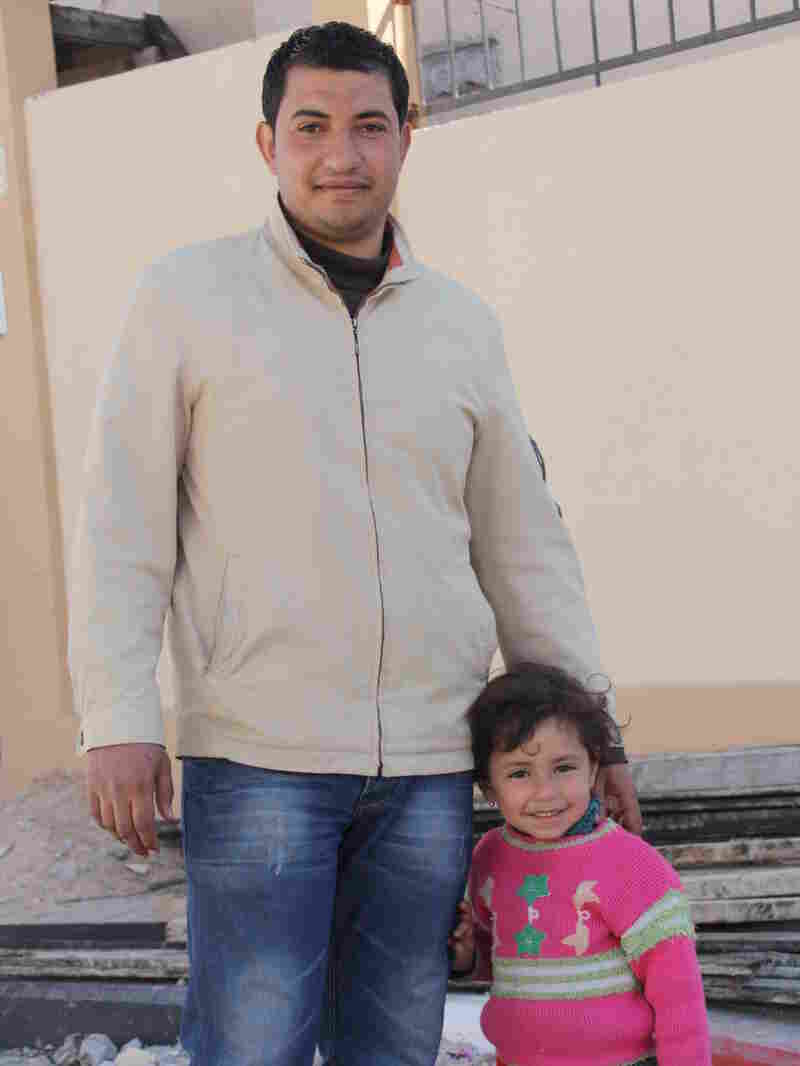 Waji el Jebaley and his daughter stand in front of their newly constructed home in Rafah, a town at the southern edge of the Gaza Strip, on Feb. 20.
