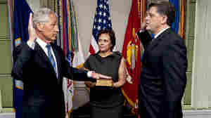 As his wife Lilibet holds the Bible, Chuck Hagel (L) is sworn into office on Feb. 27, 2013.