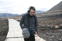 Efterklang's singer, Casper Clausen, records the sound of his footsteps on a long boardwalk running out of town. The sound can be heard in the opening of the song