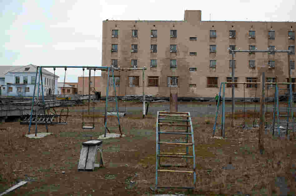 Empty buildings and rusty swing sets in the town of Piramida. The Russian mining colony that built and populated the settlement abandoned it in 1998.