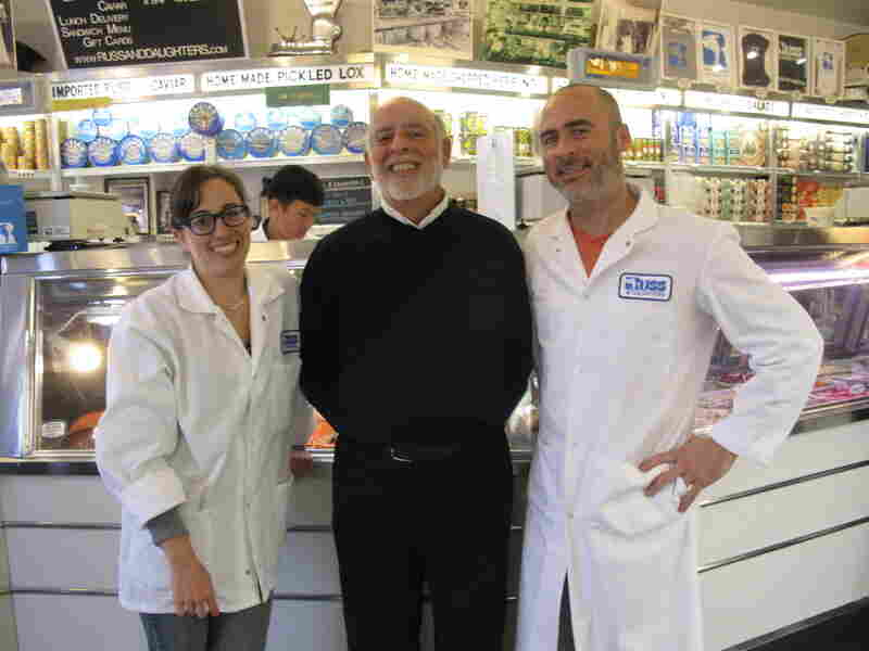 Mark Russ Federman (center) stands with the next generation of Russ and Daughters owners: his daughter Nikki and his nephew Josh Russ Tupper.